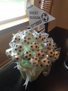Soccer cake pops in pot with banner